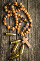 Rosary beads and pistol bullets. - PhotoDune Item for Sale
