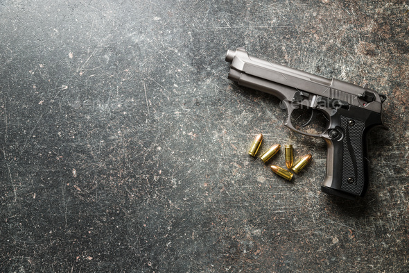 9mm pistol bullets and handgun. - Stock Photo - Images