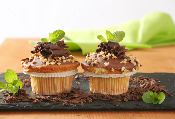 Hazelnut muffins with chocolate topping - Stock Photo - Images