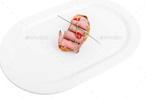 Delicious bruschetta with roast beef and scallions. - Stock Photo - Images
