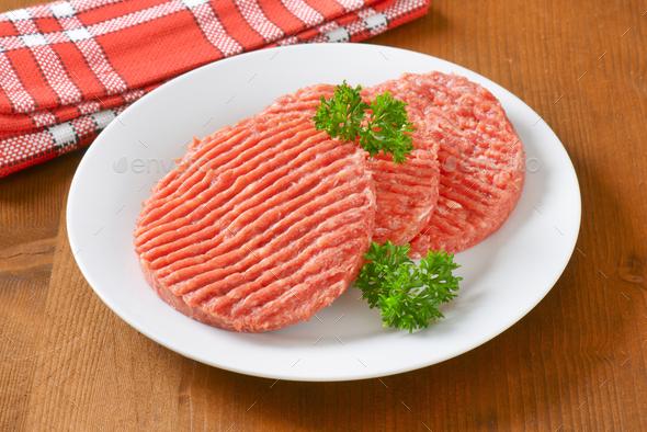 raw hamburger patties - Stock Photo - Images