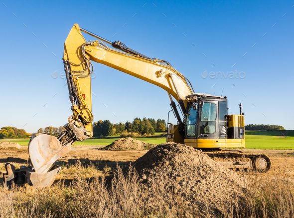 Yellow earth mover at a construction site - Stock Photo - Images