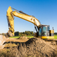 Yellow earth mover at a construction site - PhotoDune Item for Sale