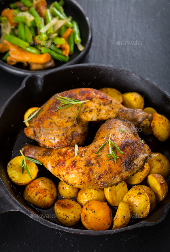 Baked chicken legs with potatos - Stock Photo - Images