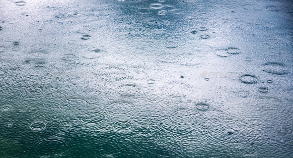 Abstract background, rain drops on the water - Stock Photo - Images
