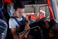 young worker checks trucks documentation - PhotoDune Item for Sale