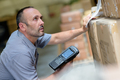 worker with portable barcode scanner in warehouse - PhotoDune Item for Sale