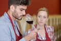 couple of winemakers tasting red wine - PhotoDune Item for Sale