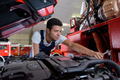 specialist truck mechanic in the car service - PhotoDune Item for Sale