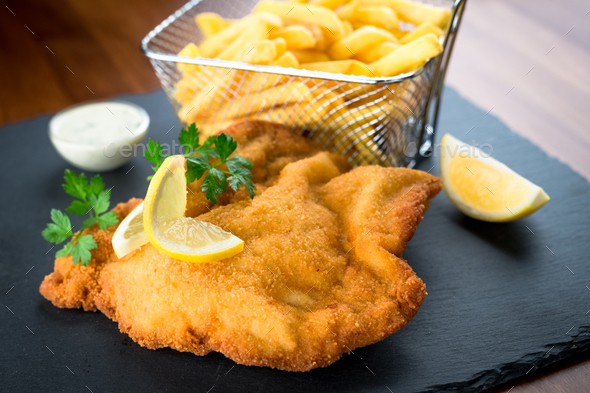 Wiener schnitzel with fried potatoes - Stock Photo - Images