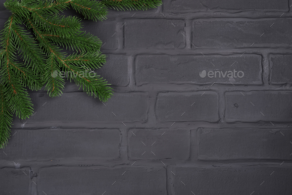 Christmas tree on brick wall background - Stock Photo - Images