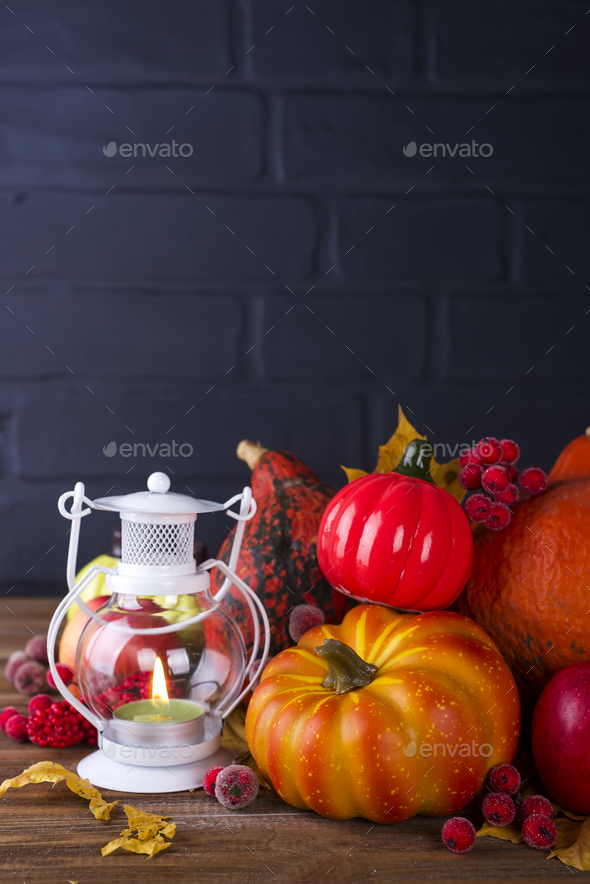 Lantern with candle, pumpkins and autumn decorations - Stock Photo - Images