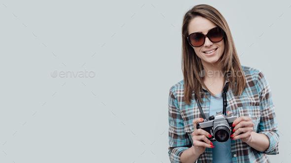Smiling female photographer - Stock Photo - Images