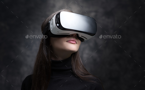 Young woman wearing virtual reality glasses - Stock Photo - Images