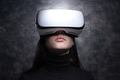 Young woman wearing virtual reality glasses - PhotoDune Item for Sale