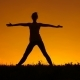 Silhouette of a Beautiful Yoga Woman at Sunset - VideoHive Item for Sale
