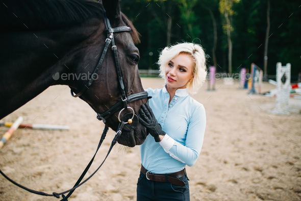 Woman hugs her horse, friendship, horseback riding - Stock Photo - Images