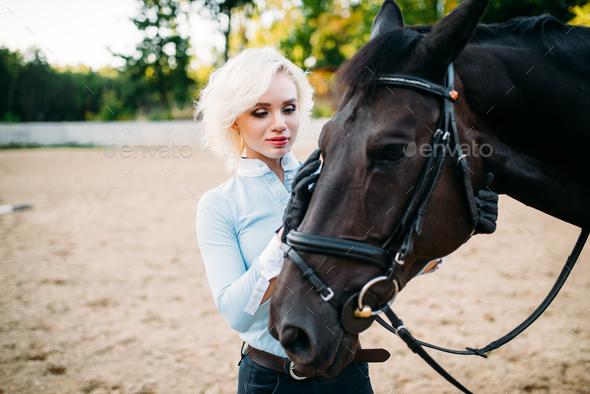 Female jockey and horse, horseback riding - Stock Photo - Images