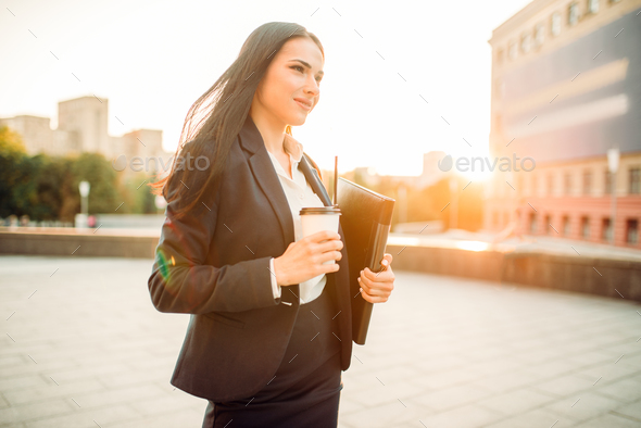 Business woman in suit with notebook and coffee - Stock Photo - Images