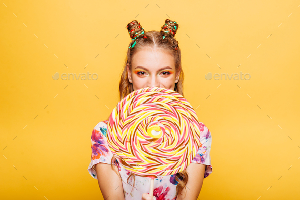 Woman with huge candy instead of a head - Stock Photo - Images