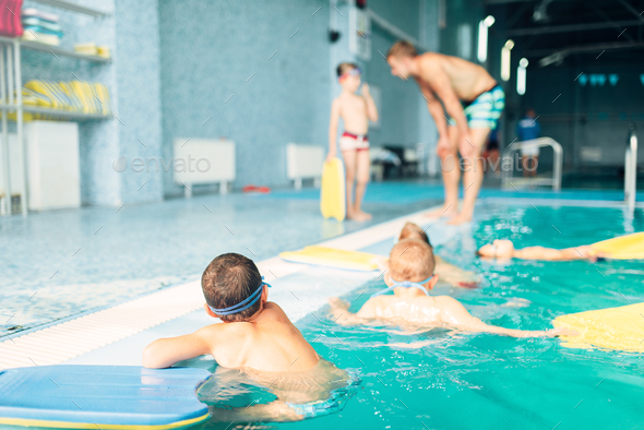 Children swimming in pool - Stock Photo - Images