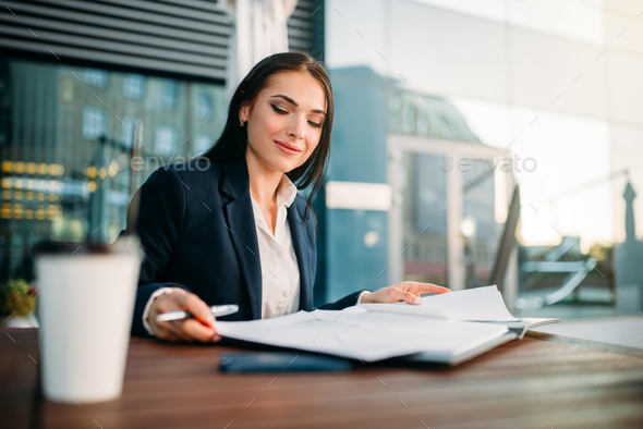 Attractive business woman works at lunch in cafe - Stock Photo - Images