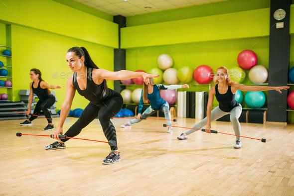 Women group exercising on fitness training - Stock Photo - Images