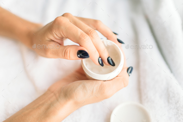 Female person hands with beauty product closeup - Stock Photo - Images