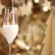 Champagne Poured Into a Glass with Christmas Decorations - VideoHive Item for Sale