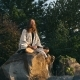 Yogi Sitting on the Rock and Meditating - VideoHive Item for Sale