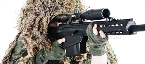 Army sniper wearing a ghillie suit - Stock Photo - Images