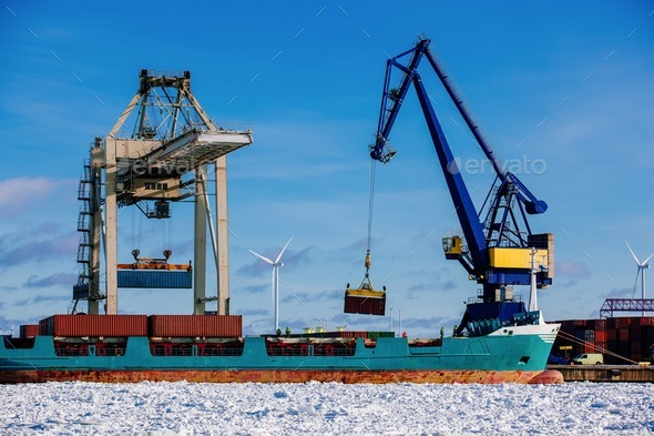 Industrial port with containers, vessel loading in port of Finland - Stock Photo - Images