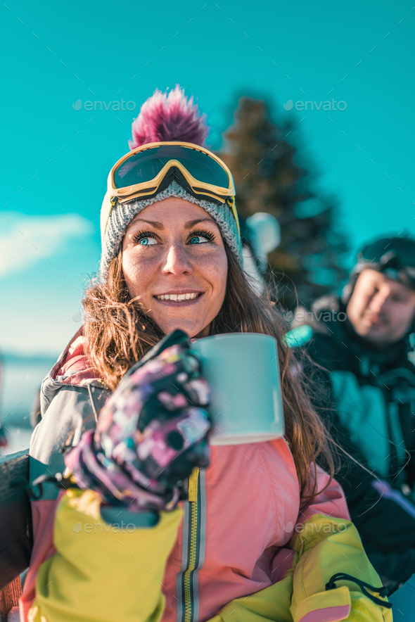 Friends enjoying the winter day on mountain - Stock Photo - Images