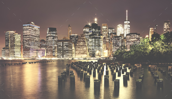 Vintage toned picture of Manhattan at night, NYC. - Stock Photo - Images