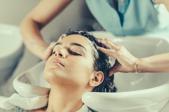 Washing hair in hair salon - Stock Photo - Images
