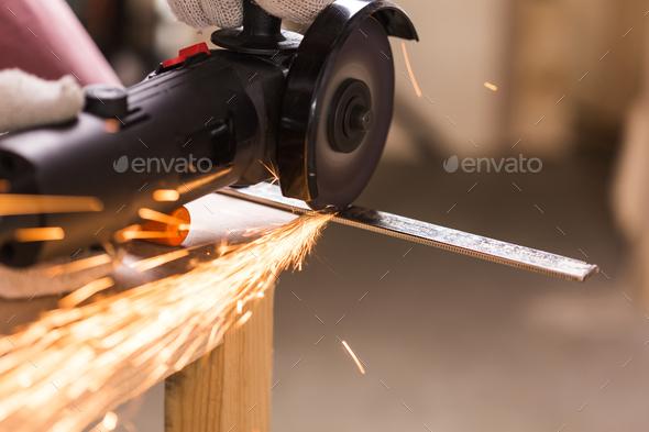 Angel grinder make a flash sparks - Stock Photo - Images
