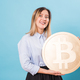 Funny woman holding a Golden Bitcoin. virtual money. - PhotoDune Item for Sale