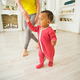 Cute little baby learning to walk, mom is holding his hands - PhotoDune Item for Sale