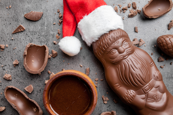 Delicious Christmas chocolate and sweets on rustic background - Stock Photo - Images