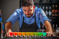 Barman with rainbow cocktai