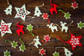 Collection of handmade Christmas ornaments on wooden background