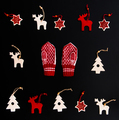 Collection of handmade felt Christmas ornaments and a pair of child glove on black
