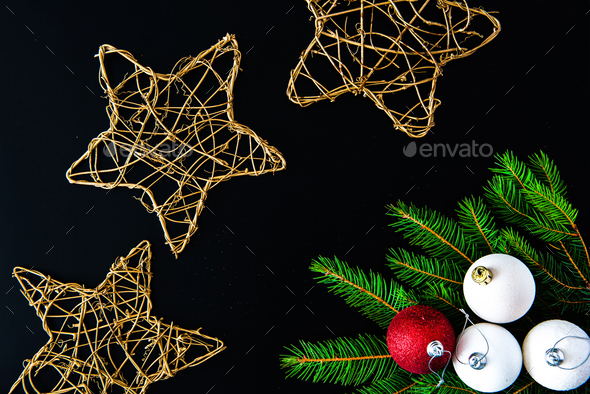 Christmas background with balls, golden snowflakes and fir tree branches on black - Stock Photo - Images