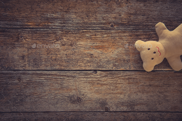 Teddy bear on toned wooden background. Space for text - Stock Photo - Images