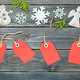 Christmas decoration and red gift tags on wooden background - PhotoDune Item for Sale