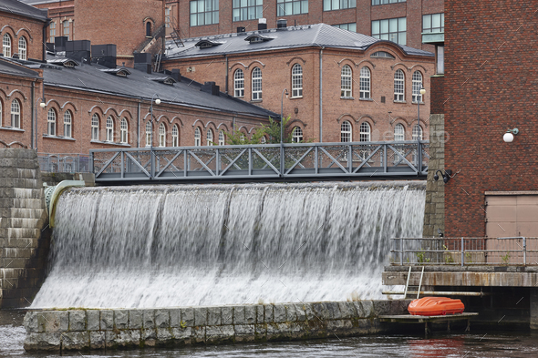 Traditional industrial buildings and dam in Tampere city center. Finland - Stock Photo - Images
