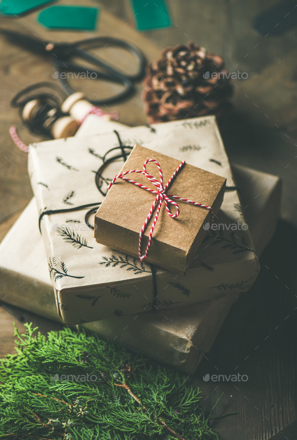 Gift boxes, rope, fur branches, scissors, selective focus - Stock Photo - Images