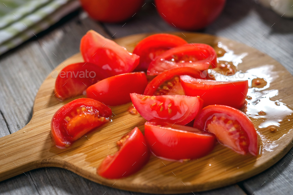 Fresh tomatoes  on a rustic  background - Stock Photo - Images