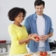 Couple Cooking Food and Juggling Tomatoes at Home  - VideoHive Item for Sale