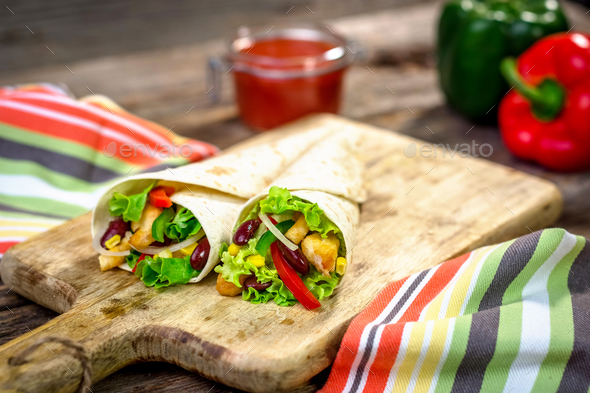 Meat and vegetables wrapped in a tortilla - Stock Photo - Images